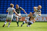 Nick Abendanon of Bath Rugby is tackled by George Skivington of London Irish during the Aviva Premiership match between London Irish and Bath Rugby at the Madejski Stadium on Saturday 22nd September 2012 (Photo by Rob Munro)