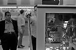 One armed bandits arcade slot machines, man playing  gambling. Big Bertha a giant one arm bandit in a Penny Arcade. 1969, Reno Nevada Casino. USA