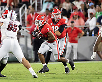 ATHENS, GA - SEPTEMBER 18: Kendall Milton #2 runs with the ball after a handoff from JT Daniels #18 during a game between South Carolina Gamecocks and Georgia Bulldogs at Sanford Stadium on September 18, 2021 in Athens, Georgia.
