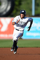 West Michigan Whitecaps second baseman Javier Betancourt (7) runs the bases during a game against the Great Lakes Loons on June 4, 2014 at Fifth Third Ballpark in Comstock Park, Michigan.  West Michigan defeated Great Lakes 4-1.  (Mike Janes/Four Seam Images)