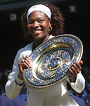 aJuly 4, 2009.Serena Williams poses with trophy after defeating her sister, Venus 7-6, 6-2 in the final of the Wimbledon Championships at the All England Lawn Tennis Club, Wimbledon, England
