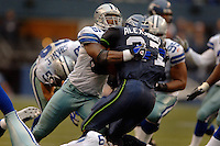 Oct 23, 2005; Seattle, Wash, USA;  Seattle Seahawks running back #37 Shaun Alexander is tackled by Dallas Cowboys safety #29 Keith Davis in the second quarter at Qwest Field. Mandatory Credit: Photo By Mark J. Rebilas