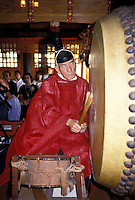 Shinto priest with drum at Japanese wedding.