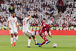 Salem Al Hajri of Qatar (R) fights for the ball with Ismail Ahmed Mohamed of United Arab Emirates (C) during the AFC Asian Cup UAE 2019 Semi Finals match between Qatar (QAT) and United Arab Emirates (UAE) at Mohammed Bin Zaied Stadium  on 29 January 2019 in Abu Dhabi, United Arab Emirates. Photo by Marcio Rodrigo Machado / Power Sport Images
