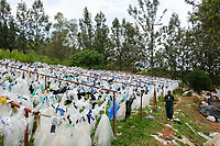 RWANDA, Kigali, plastic recycling at company ecoplastics,  drying of old plastic foils before processing to granules which is used for new plastic products / RUANDA, Kigali, plastic recycling bei Firma Ecoplastics, Trocknung von alten Folien bevor sie zu Granulat recycelt werden