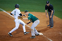 Siena Saints first baseman Joe Drpich (47) waits for a pickoff attempt throw as John Fussell (12) gets back to the bag with umpire Rob Healey looking on during a game against the Stetson Hatters on February 23, 2016 at Melching Field at Conrad Park in DeLand, Florida.  Stetson defeated Siena 5-3.  (Mike Janes/Four Seam Images)