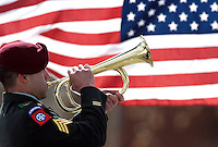 """A member of the honor guard plays """"Taps"""" on the bugle during a funeral service for Eric O'Hara at Fort Logan National Cemetery in Denver on Thursday afternoon."""