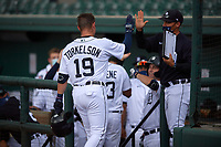 Detroit Tigers Spencer Torkelson (19) high fives teammates and coaches after hitting a home run during a Florida Instructional League game against the Toronto Blue Jays on October 19, 2020 at Joker Marchant Stadium in Lakeland, Florida.  (Mike Janes/Four Seam Images)