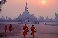 Early morning in Vientiane 1992, a group of Buddhist Monks walking at the center of town