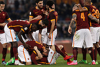 Calcio, Serie A: Roma vs Frosinone. Roma, stadio Olimpico, 30 gennaio 2016.<br /> Roma's Stephan El Shaarawy, bottom center, celebrates with teammates after scoring during the Italian Serie A football match between Roma and Frosinone at Rome's Olympic stadium, 30 January 2016.<br /> UPDATE IMAGES PRESS/Isabella Bonotto
