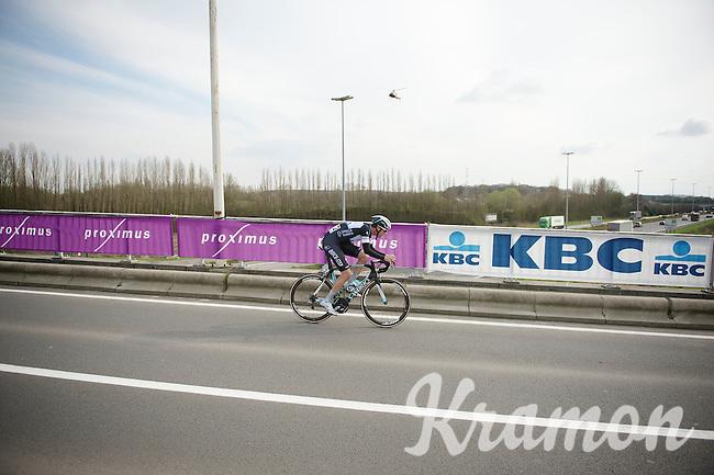 Niki Terpstra (NLD) crosses the bridge over the E17 highway and has 5 kilometres left to fight<br /> <br /> Dwars Door Vlaanderen 2014