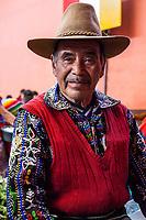 Chichicastenango, Guatemala.  Quiche (Kiche, K'iche') Man in Indoor Market, Sunday Morning.