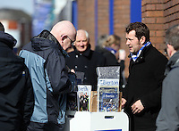 Pictured: A match programme seller outside Goodison Park. Saturday 22 March 2014<br /> Re: Barclay's Premier League, Everton v Swansea City FC at Goodison Park, Liverpool, UK.