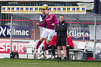13th March 2021; Dens Park, Dundee, Scotland; Scottish Championship Football, Dundee FC versus Arbroath; Scott Stewart of Arbroath competes in the air with Jordan Marshall of Dundee