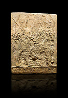 Hittite sculpted orthostats panels of Long Wall Limestone, Karkamıs, (Kargamıs), Carchemish (Karkemish), 900-700 B.C. Soldiers. Anatolian Civilisations Museum, Ankara, Turkey<br /> <br /> Figure of two helmeted warriors. They have their shield in their back and their spear in their hand. The prisoner in their front is depicted as small. The lower part of the orthostat is decorated with braiding motifs. <br /> <br /> On a black background.