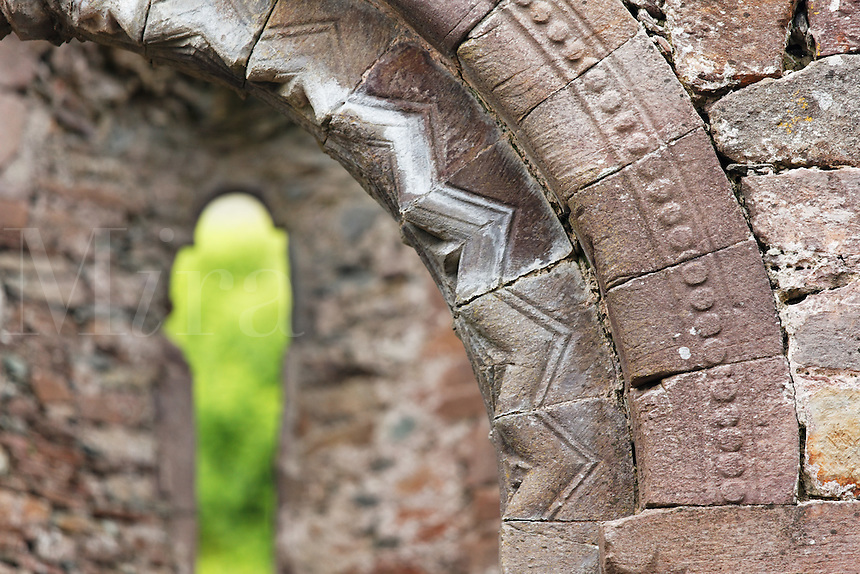 Detail of arched Romanesque doorway within ruined church of Kilmalkedar (Cill Mhaoilcheadair), Dingle Peninsula, County Kerry, Republic of Ireland