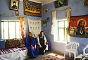 Turkey 1997.In the region of Tour Abdin, the priest of Midin with his wife in their house.Turquie 1997.Region de Tour Abdin, le pretre du village de Midin chez lui avec sa femme