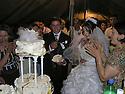 Armenia 2007 <br /> A Yezidi wedding: the newlyweds sharing  the wedding cake <br /> Armenie 2007 <br /> Un mariage Yezidi dans un village: les jeunes maries mangeant du gateau de mariage entourés de leurs invites.