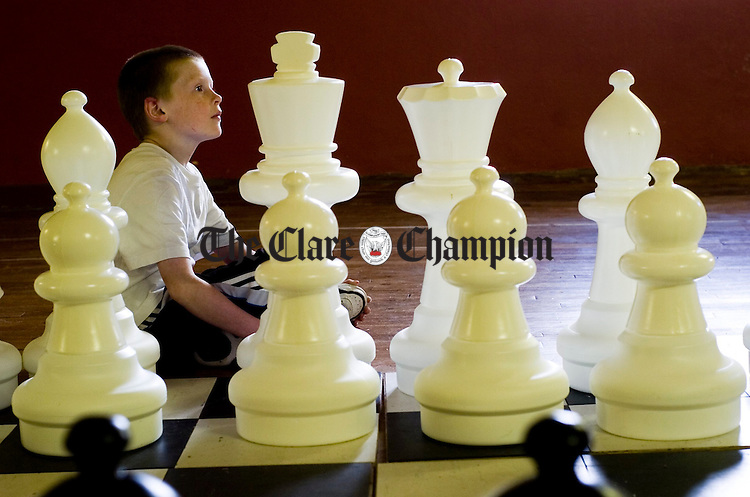 Davy Martyn with a giant chess set at the West Clare Chess-athon for the People in Need Telethon. Photograph by John Kelly.