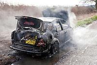 Remains of an abandoned car smouldering following a severe fire..©shoutpictures.com..john@shoutpictures.com