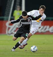 Alecko Eskandarian (11) is fouled by Seth Stammler (6). DC United tied the New York Red Bulls 1-1 and won on a 2-1 aggregate in their Eastern Conference Semifinals series on Sunday, November 29, 2006 at RFK Stadium.