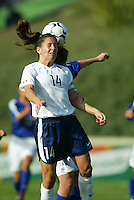 Joy Fawcet goes up for a header against Japan  during a 0-0 tie in San Diego, Calif., January 12, 2003.