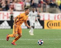 FOXBOROUGH, MA - JUNE 29: Tomas Martinez #10 dribbles at midfield during a game between Houston Dynamo and New England Revolution at Gillette Stadium on June 29, 2019 in Foxborough, Massachusetts.