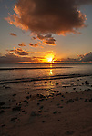 The setting sun om the island of Kiritimati in Kiribati.