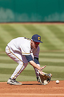 California Golden Bears shortstop Chris Paul #6 fields a grounder during the NCAA baseball game against the Baylor Bears on March 1st, 2013 at Minute Maid Park in Houston, Texas. Baylor defeated Cal 9-0. (Andrew Woolley/Four Seam Images).