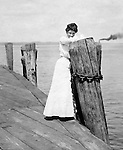 Lakewood NY: Young woman waiting for the City of Cleveland Ferry on the Kent House Pier. Photographs taken during a church field trip to Chautauqua Institution in New York (Lake Chautauqua). The Stewart family and friends visited Chautauqua during 1901 to hear Stewart relative, Dr. S.H. Clark  speak at the institute. Alice Brady Stewart chaperoned and Brady Stewart came along to photograph the trip.  The Gallery provides a glimpse of how the privileged and church faithful spent summers at Lake Chautauqua at the turn of the century.