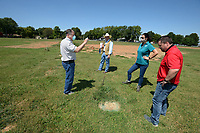 Al Drinkwater (from left), a volunteer environmental quality consultant, helps answer questions Friday, Aug. 21, 2020, as Heath Ward, executive director of Springdale Water Utilities; Kim Patulak, human resources director for the city; and Chris Clark, financial analyst for Springdale Water Utilities, listen while the four inspect the former Bethel Heights wastewater treatment facility. The Benton County Election Commission certified that the results of an Aug. 11 election to annex Bethel Heights into Springdale. Visit nwaonline.com/200823Daily/ for today's photo gallery.<br /> (NWA Democrat-Gazette/Andy Shupe)
