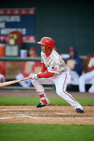 Harrisburg Senators right fielder Yadiel Hernandez (12) follows through on a swing during the second game of a doubleheader against the New Hampshire Fisher Cats on May 13, 2018 at FNB Field in Harrisburg, Pennsylvania.  Harrisburg defeated New Hampshire 2-1.  (Mike Janes/Four Seam Images)