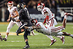 Baylor Bears wide receiver Corey Coleman (1) gets tackled by Oklahoma Sooners linebacker Aaron Franklin (25) during the game between the Oklahoma Sooners and the Baylor Bears at the Floyd Casey Stadium in Waco, Texas. Baylor defeats OU 41 to 12.