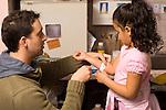 Education preschool 4-5 year olds male teacher looking at injury on girl's arm or applying bandaid