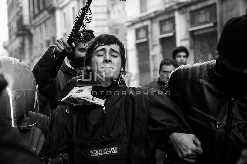 A rioter is being arrested during the clashes in Rome after the Senate and Lower House vote of confidence that resulted in a razor-thin victory for Berlusconi to continue his mandate. Rome, Italy. 14 Dec. 2010