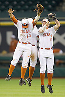 Ben Johnson (left), Zane Gurwitz (center) and Collin Shaw of the Texas Longhorns celebrate their victory over the Rice Owls at Minute Maid Park on February 28, 2014 in Houston, Texas.  The Longhorns defeated the Owls 2-0.  (Brian Westerholt/Four Seam Images)