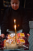 Romania. Iași County. Iasi. A nun from the Frumoasa Monastery is holding in her hands two bread loafs with two burning candles. Burning candles in the Orthodox Christian context is a symbol of a worshiper offering all kind of gifts, such as bread, for the soul of dead people. It is also a symbol that represents the Light of God or, more specifically, the Light of Christ. The Frumoasa Monastery (Romanian: Mănăstirea Frumoasa) is a Romanian Orthodox monastery . It was built between 1726 and 1733, by Moldavian Prince Grigore II Ghica, The monastery is listed in the Romanian National Register of Historic Monuments. Iași (also referred to as Iasi, Jassy or Iassy) is the largest city in eastern Romania and the seat of Iași County. Located in the Moldavia region, Iași has traditionally been one of the leading centres of Romanian social life. The city was the capital of the Principality of Moldavia from 1564 to 1859, then of the United Principalities from 1859 to 1862, and the capital of Romania from 1916 to 1918. 10.06.15 © 2015 Didier Ruef