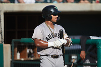 Willie Carter (15) of the Augusta GreenJackets waits for his turn to hit during the game against the Charleston Boiled Peanuts at Joseph P. Riley, Jr. Park on June 26, 2021 in Charleston, South Carolina. (Brian Westerholt/Four Seam Images)