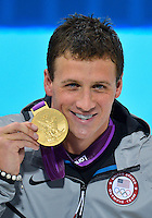 July 28, 2012: Ryan Lochte of USA poses with 400 meter individual medley Gold Medal at the Aquatics Center on day one of 2012 Olympic Games in London, United Kingdom.