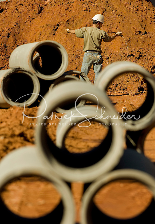 02/22/07:  A construction worker prepares to lay the infrastructure during expansion/construction of a Charlotte-area shopping center. Charlotte, NC, is one of the country's fastest-growing cities. ..By Patrick Schneider- Patrick Schneider Photography.