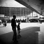 A father and his son roller-blading under the airplane stationed at the VVC, former VDNKh. Moscow, 2009
