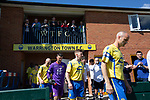 The teams making their way on to the pitch before Warrington Town (in yellow) played King's Lynn Town in the Northern Premier League premier division super play-off final tie at Cantilever Park, Warrington. The one-off match was between the winners of play-off matches in the Northern Premier League and the Southern League Premier Division Central to determine who would be promoted to the National League North. The visitors from Norfolk won 3-2 after extra-time, watched by a near-capacity crowd of 2,200.