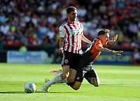 Swansea City's Barrie McKay is tackled by Sheffield United's Chris Basham during the Sky Bet Championship match between Sheffield United and Swansea City at Bramall Lane, Sheffield, England, UK. Saturday 04 August 2018