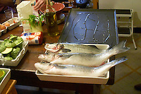 How to prepare fish baked in the oven in salt crust (en croute de sel), recipe, series of pictures: three fish on the preparation table cleaned and ready to be prepared with salt Clos des Iles Le Brusc Six Fours Cote d'Azur Var France