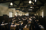 Royal Guildford Grammar School. Boys taking an exam. School alumni on the rafters of the Great Hall. 1980s