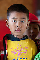 Myanmar, Burma.  Little Burmese Boy of Pre-School Age, Intha Ethnic Group, Inle Lake, Shan State.  He has remnants of thanaka paste on his face, a cosmetic sunscreen.
