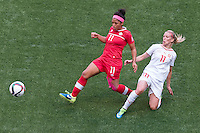 June 21, 2015: Desiree SCOTT of Canada and Lara DICKENMANN of Switzerland compete for the ball during a round of 16 match between Canada and Switzerland at the FIFA Women's World Cup Canada 2015 at BC Place Stadium on 21 June 2015 in Vancouver, Canada. Canada won 1-0. Sydney Low/Asteriskimages.com