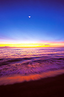 Sunset on Wailua beach with cresent moon, island of Kauai