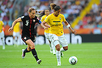 Christie Rampone (l) of team USA and Cristiane of team Brazil during the FIFA Women's World Cup at the FIFA Stadium in Dresden, Germany on July 10th, 2011.