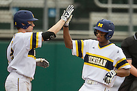 Michigan Wolverines outfielder Johnny Slater (25) scores during the NCAA baseball game against the Washington Huskies on February 16, 2014 at Bobcat Ballpark in San Marcos, Texas. The game went eight innings, before travel curfew ended the contest in a 7-7 tie. (Andrew Woolley/Four Seam Images)
